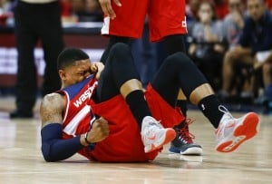 Washington Wizards guard Bradley Beal (3) reacts after being injured in the second half of an NBA second-round basketball payoff series game against the Atlanta Hawks, Sunday, May 3, 2015, in Atlanta. Beal returned to the game and Washington won 104-98. (AP Photo/John Bazemore)