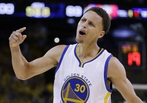 Golden State Warriors guard Stephen Curry (30) celebrates during the second half of Game 5 of basketball's NBA Finals against the Cleveland Cavaliers in Oakland, Calif., Sunday, June 14, 2015. The Warriors won 104-91. (AP Photo/Ben Margot)