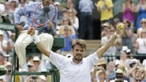 Stan Wawrinka of Switzerland celebrates winning the match against Fernando Verdasco of Spain after their singles match at the All England Lawn Tennis Championships in Wimbledon, London, Friday July 3, 2015. Wawrinka won 6-4, 6-3, 6-4. AP